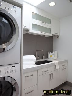 modern laundry room - I like the rails on each side for hanging clothes