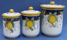 "This Limone Italian ceramic canister set looks great in almost any kitchen.   Colorfully decorated with bright yellow lemons, green leaves and a colbalt blue trim. Made in the Umbria region in Italy, famous for Italian Majolica Ceramics and Pottery.  This handmade hand painted authentic Limone canister set comes with 3 canisters.  The large canister is 9.5"" in height & 5.75"" in diameter, the medium canister is 8"" in height & 4.75"" in diameter and the small caniste..."