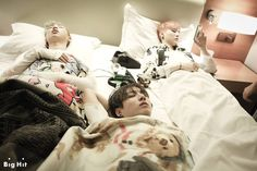 The boy band came back to the warm room after leaving the cold sea wind behind. They had a long day, they must be so tired by now~ all the members fell into deep sleep as lying down next to each other on one bed.