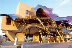 """This ribbon-like construction isan unique hotel in Spain. The hotel is designed by renowned architect Frank O. Gehry – the architect of the epoch Guggenheim Museum in Bilbao. Wine hotel """"Marques de Riscal"""" is nestled in the """"City of Wine"""" – in the heart of the Rioja."""