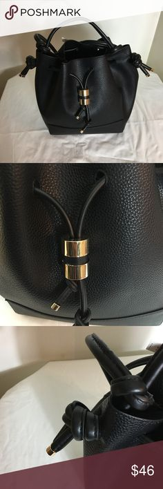 Zara Knotted Bucket Bag Bucket bag. Features contrasting topstitching, single top handle and shoulder strap and drawstring closure.  Height x Width x Depth: 28 x 23 x 14 cm. / 11.0 x 9.0 x 5.5″ Zara Bags
