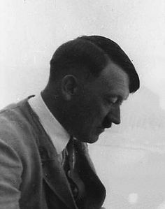 """One of Eva Braun's first photos of Adolf Hitler. This is in May, 1933 on the terrace of Haus Wachenfeld. She'd been his secret lover since November, 1931 but he still treated her merely as a sort of beautiful convenience. As he told his aide, Fritz Wiedmeann, around this time, """"and as for love, I keep a girl for myself in Munich."""" Not very romantic, but he was cavalier about it all early on. It would take Hitler several years before he genuinely fell in love with his """"girl."""" (via putschgirl)"""