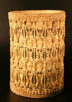 Armlet, made of ivory by Edo, Benin City. British Museum, online collection.