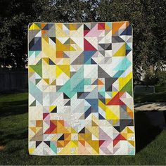 super cool and colorful modern triangle quilt
