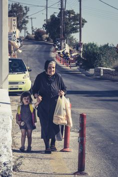 Grandmother and grandchild in Santorini island, Cyclades, Greece Learn Greek, Go Greek, Greece Culture, Greek Beauty, Cradle Of Civilization, Santorini Island, Human Poses, Athens Greece, Love At First Sight