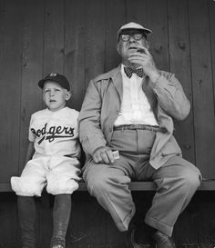 Branch Rickey watches practice with his grandson during spring training. Vero Beach, Florida, 1948. By George Silk