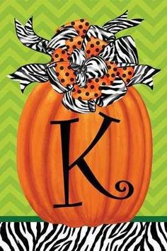 Letter K fall pumpkin monogram garden flag decorated with a combination of black…