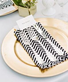 REVEL: Black + Gold Place Setting....think silver charger ..black table cloth.. Teal napkin