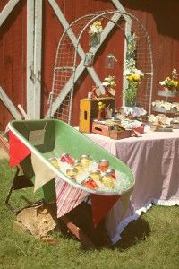 Love the decorated wheel barrow to serve drinks.