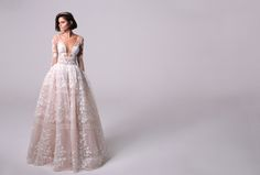 """Destination Wedding Dresses - Florida Wedding Inspiration // Michal Medina's """"Blake"""" two-piece full princess ball gown has a dramatic see-through Petticoat. The gown is fitted at the bodice with long lace sleeves and has a waistline that leads to full skirt. #destinationx"""