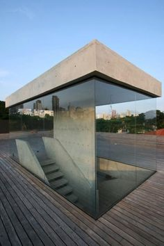 Concrete staircase with unique concrete roof and glass structure | Triptyque Architects | Sao Paulo, Brazil