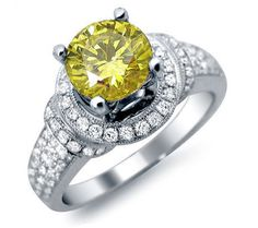 http://www.frontjewelers.net/1-91-ct-canary-yellow-round-diamond-engagement-ring-18-k-white-gold.html