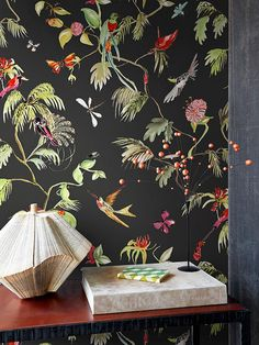 Wanderlust interior with large palm leaves and exotic birds on wallpaper by Designed for Living. #BNWallcoverings