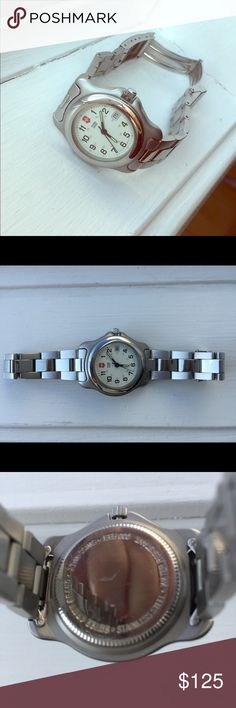Swiss Army Women's Watch EUC Gently used...working battery...comes with extra links and Swiss Army brown leather band to interchange! Swiss Army Accessories Watches