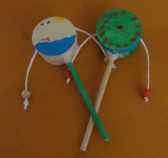 DIY: Make a den-den drum at home. Just like the ones we use in Kindermusik, only more fun! :D