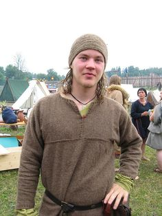 VIking with nalbinding cap. Unusual seam placement on the tunic.