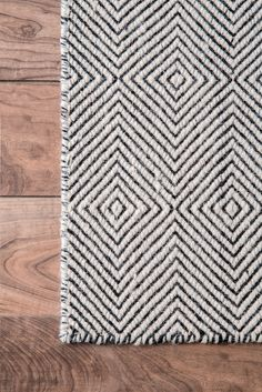 Create an urban and chic look with this contemporary hand-woven paddle rug that spells quality as well as durability. Available in subtle colors and delicate pattern in runner and rectangles forms, this rug is a wool-cotton mix that makes it soft and luxurious under the feet.