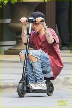 Justin Bieber Steps Out After Cancelling Thanksgiving Appearances: Photo #898545. Justin Bieber bends down low while going for a ride on a scooter outside of the W Hotel in West Hollywood on Tuesday (November 24).     The 21-year-old singer was…