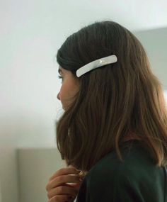 a barrette is a chic and fun way to style a lop