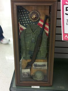 Great shadow box idea for a military member family. I'll make one for my son the Marine