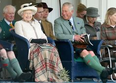 The family looked very relaxed as they giggled and flicked through a programme of the day'...
