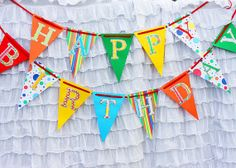 Rainbow banner made by A To Zebra Celebrations: http://www.etsy.com/listing/78003744/rainbow-happy-birthday-banner