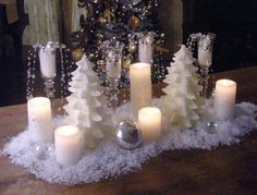 I love this idea from HGTV...since I will be doing a gold and silver themed tree in the living room, this will go nicely on the dining room table.