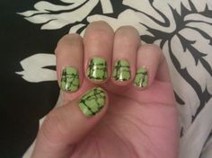 Pin for Later: 25 Cute and Creepy Nail Art Ideas For Halloween  This sharp (heh) manicure mixes barbed wire with a ghoulish green hue.  Source: Twitpic user @ashlee_costa