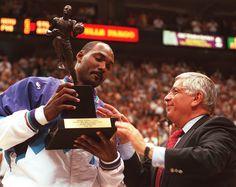 NBA commissioner David Stern presents Karl Malone the MVP trophy for the 1996-97 season.