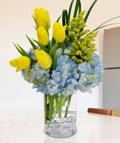 Celebrate Spring or any special occasion with this beautiful arrangement of tulips and hydrangea.
