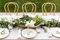 Birthday Dinner white flowers and greenery