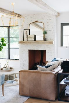 Kate Marker Interiors – Stoffer Photography – A styled rustic wood mantel is fix…, – Round Rugs Living Room Brown Leather Sofa Living Room, White Leather Sofas, Rugs In Living Room, Living Room Designs, Modern Farmhouse Interiors, French Country Interiors, Farmhouse Design, Farmhouse Style, Wood Mantels