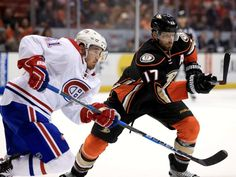Ryan Kesler of the Anaheim Ducks and Paul Byron of the Montreal Canadiens skate to a puck during the third period of a game at Honda Center Nov. 2016 in Anaheim, California. Ryan Kesler, First Period, Anaheim California, Fall Shorts, Anaheim Ducks, Montreal Canadiens, Nhl, Motorcycle Jacket, Skate