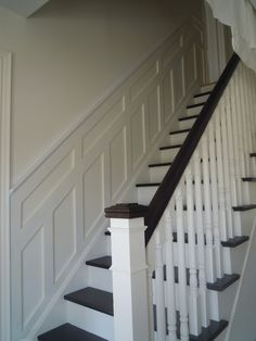 Open stairs, clean lines and crisp wainscoting.