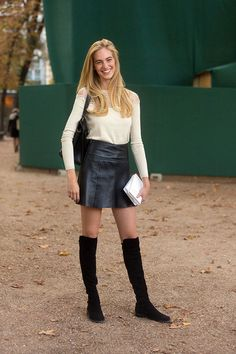 Leather mini skirt, lace top and knee high boots. Image via LA COOL & CHIC
