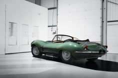 "The original Jaguar XKSS is among the most coveted of all automobiles. Now the people who purchased Jaguar's new classic ""continuation"" XKSS roadsters look set to double their money simply by taking delivery. New Jaguar, Jaguar Xk, Jaguar Land Rover, Type E, Car Makes, Steve Mcqueen, Back To The Future, Aston Martin, Vintage Cars"