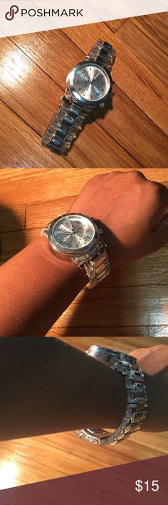 Quartz Silver Watch The band is too big for my small wrist. Does have minor scratches. Battery still works. Clasp is still functional. Quartz Accessories Watches