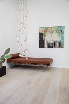 An iconic daybed in a spacious nordic styled home.