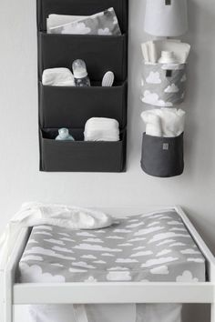 Diaper Storage Ideas - Here is another great example using wall organizers for diaper storage.