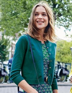 This cropped cardigan is the perfect green for going into fall