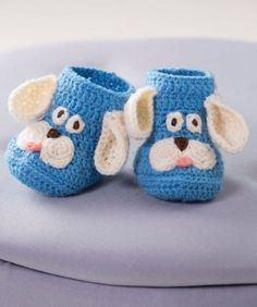 Crochet these adorable puppy booties for the baby in your life! Any of the colou… Crochet these adorable puppy booties for the baby in your life! Any of the colours of our soft Baby yarn can be used as the main shade. Crochet Baby Boots, Crochet Baby Clothes, Crochet Slippers, Cute Crochet, Crochet For Kids, Crochet Hats, Baby Slippers, Crochet Animals, Crochet Top
