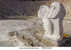 Roman theatre of Medellin, Spain. Winged lion sculpture in orchestra side