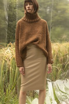 e6123500826a Pullover sweater with chimney collar with dropped shoulders. Gently tapered  long sleeves. Slightly cropped