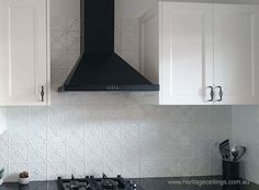 This is another splash back project using the Rosemary pressed tin design. The panels are light-weight and easy to install plus they are inexpensive. See lots more projects here: http://www.heritageceilings.com.au/tin-ceilings-projects.php
