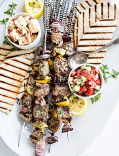 Fresh summer meals and outdoor entertaining are where it is at when it comes to this Greek Pork Kebab Platter with Greek Pico de Gallo. Juicy chunks of pork tenderloin are grilled with onion, lemon, and oregano and served platter style with Greek Pico de Grilling Recipes, Pork Recipes, Cooking Recipes, Healthy Recipes, Greek Recipes, Light Recipes, Summer Recipes, Easy Dinner Recipes, Tomato Florentine Soup