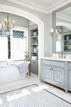 Stunning powder blue/grey bathroom, painted vanity, joinery details, marble tiles, lights.