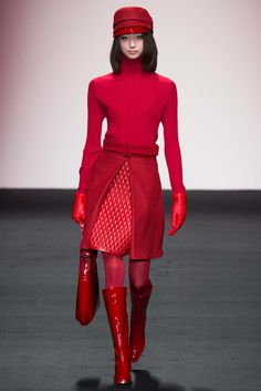 Daks - Fall 2015 Ready-to-Wear - Red from head to toe: cap poor-boy ribbed turtleneck, A-line skirt with plastic quilted inset, red tights and shiny red boots and gloves and bag. whew.