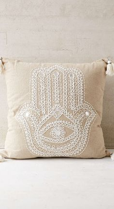 embroidered hamsa pillow
