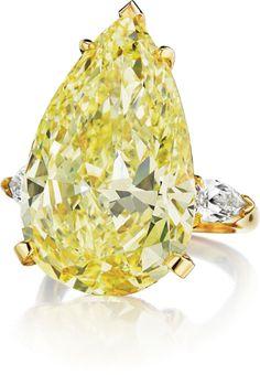 A Superb Fancy Intense Yellow Diamond Ring...1.1 million dollars Fancy!