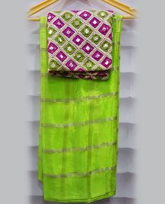 Albeli checks Saree with designer Mirror Work Blouses... Latest albelli checks saree with designer blouse .sarees have different nice bright colors with mirror designer blouse.Size : Can be customised upto Size 42 (We provide tailoring also)To BUy This sarees details